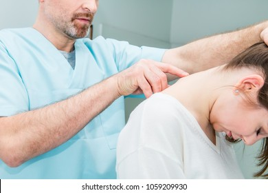 Close up Male neurologist doctor examines cervical vertebrae of female patient spinal column in medical clinic. Neurological physical examination. Osteopathy, chiropractic, physiotherapy