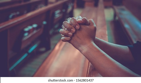 Close up male prayer's hand pray in church, Pastor pray to God, with blank copy space