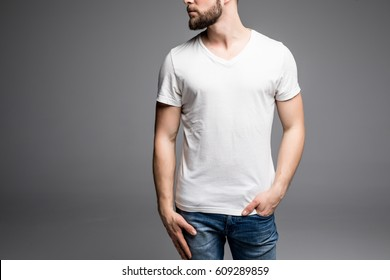 close up of man in blank t-shirt on grey