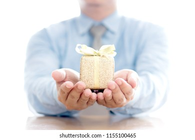 Close up of man with blue present box