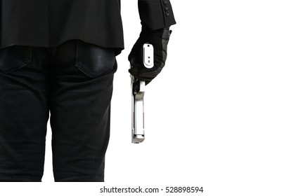 Close up of man in business suit holding a gun.