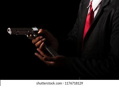 Close up Man changing gun magazines.