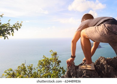 Close up to Man Climbing to the top of mountain,Business concept.