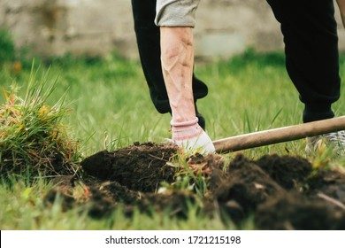 Close up man digs soil with metal shovel. Digging ground for plant seeding. Agriculture concept. Worker in gloves. Copy space.