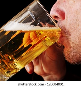 Close Up of a Man Drinking a Glass of Beer
