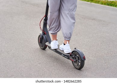 Close up of man driving on electric scooter in city