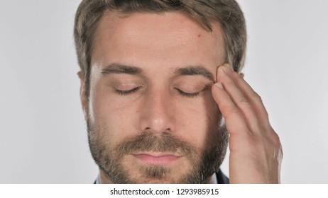 Close Up of Man Face Gesturing Headache, Stress
