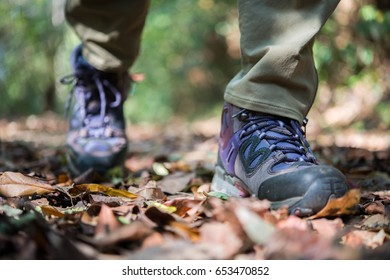 Close up of man feet while hiking in nature.