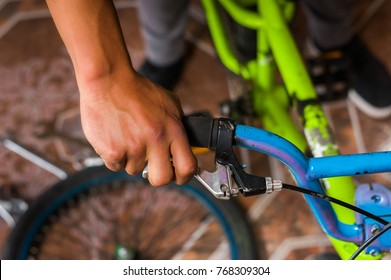 Close up of man fixing the handlebar of the bicycle, in a workshop