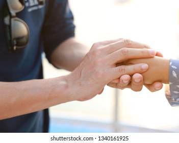 Close up of Man hand  with client holding hands together for help as  a comfort and support work together, insurance team,respect and trust concept