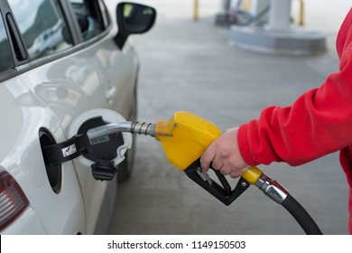 Close up man hand filling the white car with fuel