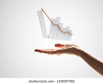 Close up of man hand holding growing bar graph on gray background