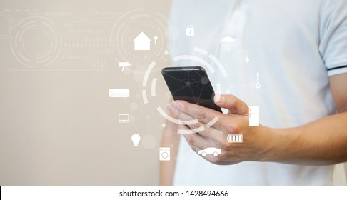close up man hand holding smartphone and turn on wifi technology for using home automation function to looking inside or outside home and property , ai innovation future concept