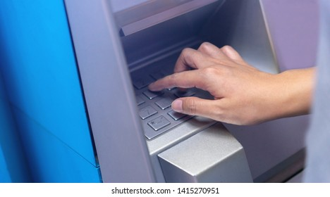 close up man hand pressing number on atm machine for withdraw or deposit cash (money) , business technology concept