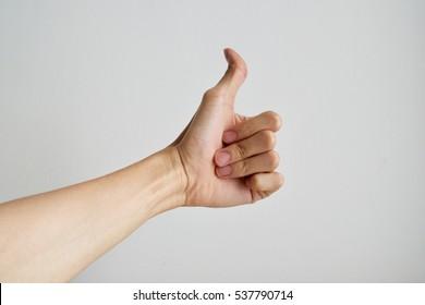 close up man hand showing thumb up
