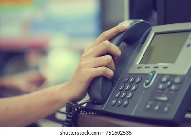 close up man hand touching telephone handset for make a call concept.