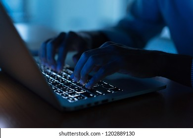 close up man hand typing keyboard input code for register system structure or unlock password on laptop in darkness operation room, cyber security concept