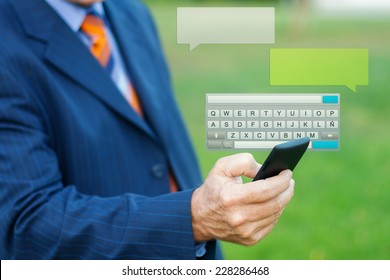 Close up of a man hand typing a message with smartphone, blurred background