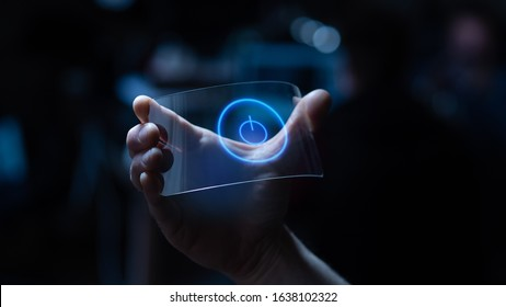 Close up of a man hand is using a futuristic liquid crystals cell phone with the latest advanced augmented reality holographic technology. Concept: future, technology,holograms