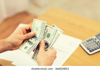 close up of man hands counting money at home