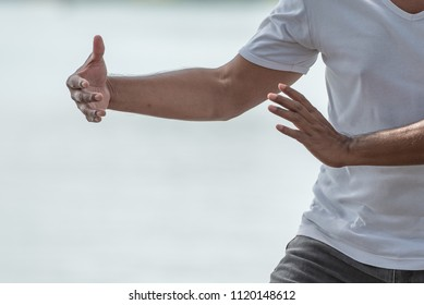 Close up of man hands doing Tai Chi or Tai ji , Traditional Chinese martial arts.