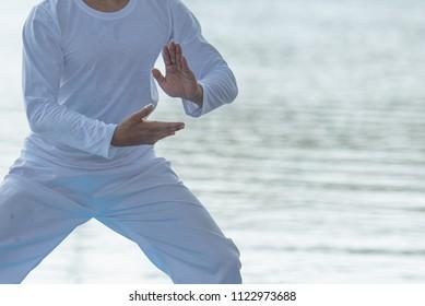 Close up of man hands doing Tai Chi or Tai ji , Traditional Chinese martial arts.