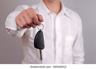 Close up of man hands holding  car key. Rent a car, car credit, buying new car concept