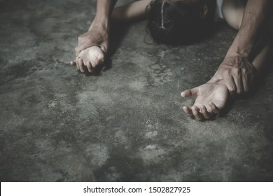 Close up of man hands holding a woman hands for rape and sexual abuse, anti-trafficking and stopping violence against women, International Women's Day