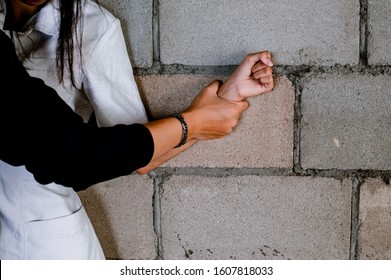 Close up of man hands holding a woman hands Man hands holding a woman hands for rape and sexual abuse concept.