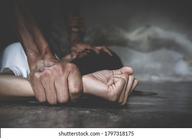 Close up  man hands holding a woman hands for rape and sexual abuse concept. Violence against women.