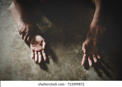 Close up of man hands holding a woman hands for rape and sexual abuse concept.