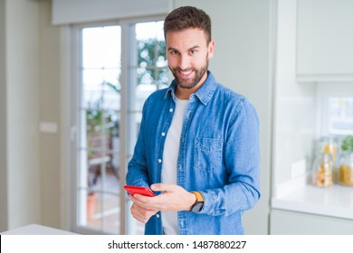 Close up of man hands using smartphone and smiling