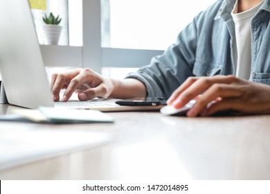 Close up of man hands working with laptop at office. Business concept.