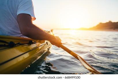 Close up of man holding kayak paddle. Kayaking, paddling, canoeing