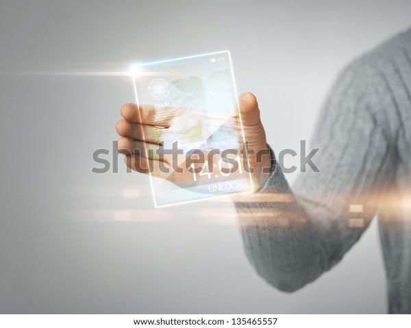 close up of man holding transparent phone