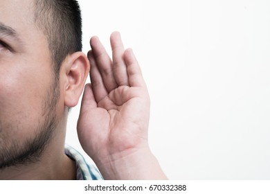 Close up of Man holds his hand near his ear and listening something isolated on white background