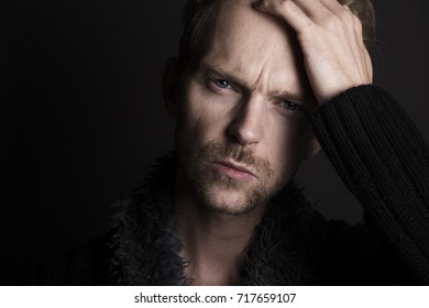 Close up of man looking depressed and tired