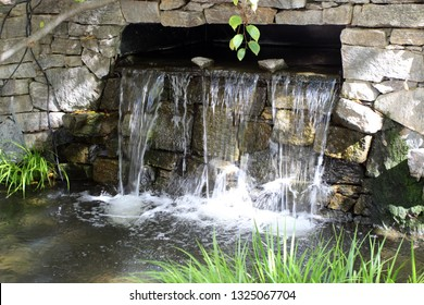 Close up of a man made waterfall and pond made with flagstone in Raleigh, North Carolina, USA