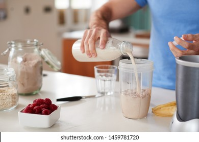 Close Up Of Man Making Protein Shake After Exercise At Home