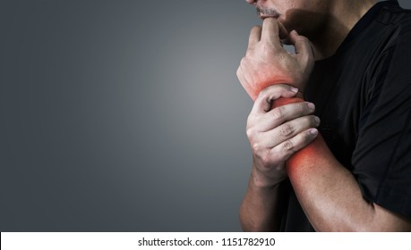 Close up man pain at the wrist office syndrome.