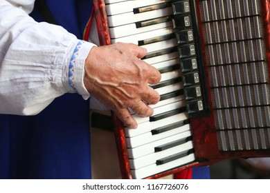 Close up of a man playing accordion