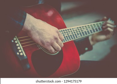 Close up man playing the guitar. Music, art, creativity concept.