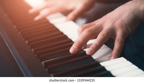 cLose up man playing piano