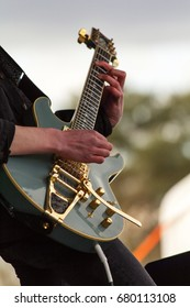 Close up of man playing a rock guitar