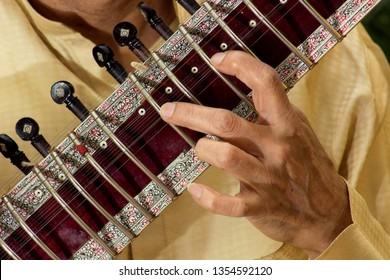 Close up man playing Sitar