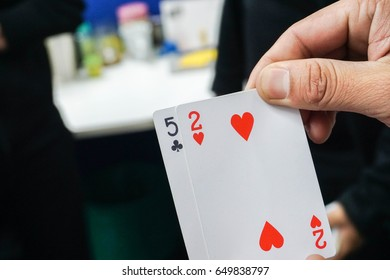 close up man with poker card for gambling