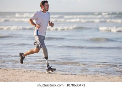 Close up of a Man With a prosthetic Leg Running Along the Beach