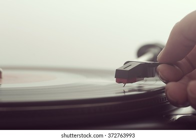 Close up of a man putting a record on turntable