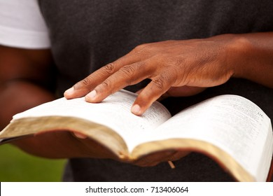 Close up of a man reading the Bible.