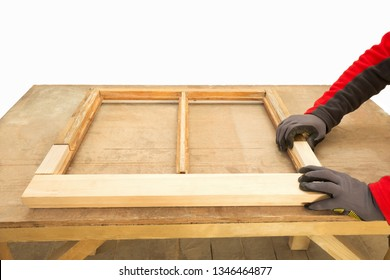 Close up of a man repairing sash window frame.